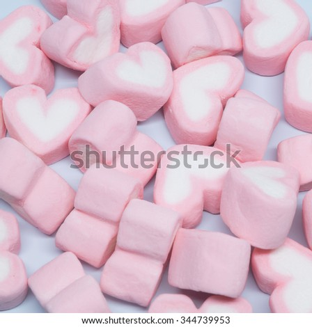 Heart marshmallow on light blue background.