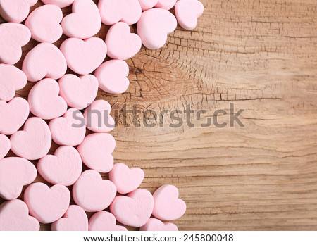 Heart Marshmallows over wooden background