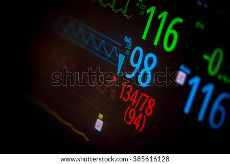 Heart monitor measuring vital signs - stock photo