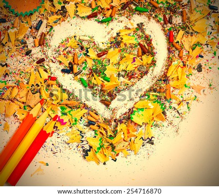 heart, multicolored pencils and varicolored wooden shavings on the white background. instagram image retro style - stock photo