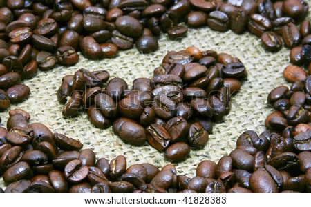 heart of cocoa beans on bagging - stock photo