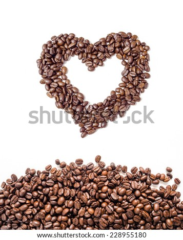 Heart of coffee beans and coffee beans group on white background. - stock photo