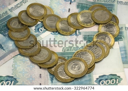 Heart of coins - symbol of love on money background - stock photo