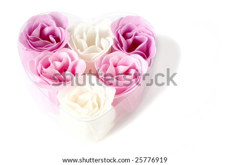 Heart of pink and white roses on white background.