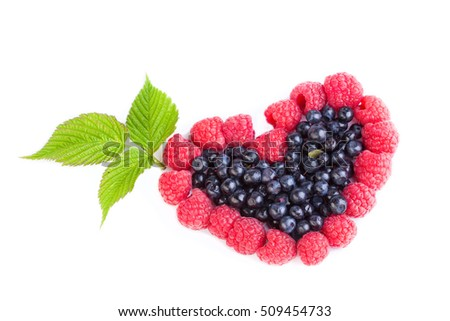 heart of raspberries and blueberries on a white background
