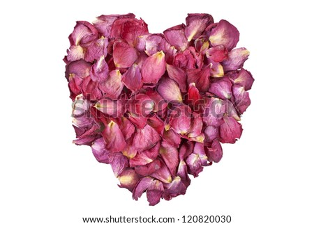 Heart of red dry roses petals isolated over white background - stock photo