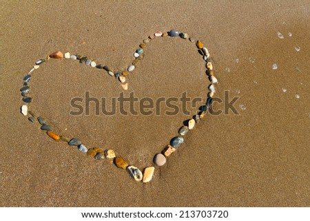 Heart of stones on the sand