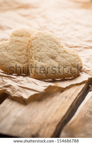 Heart of the cookie and wooden background.