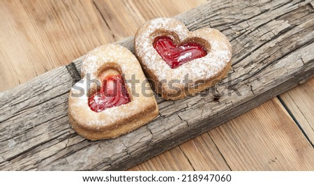Heart of the cookie and wooden background.  - stock photo
