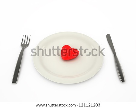 Heart on a plate, with a knife and a fork