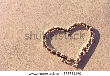 heart on a sand of beach  - stock photo