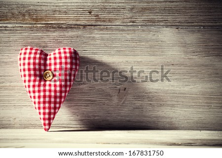 Heart on a wooden background. Vintage style. - stock photo