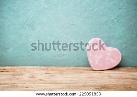 Heart on a wooden table. Valentines Day greeting card.