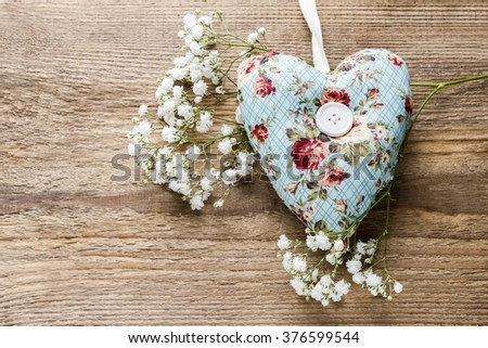 Heart on brown wooden background, copy space - stock photo