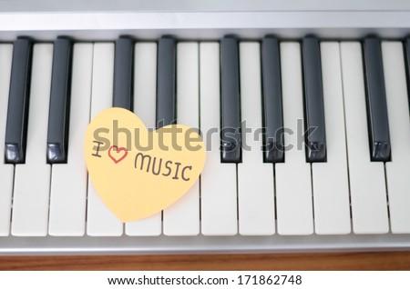 heart on key piano say love music - stock photo