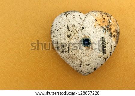 Heart on orange background - stock photo