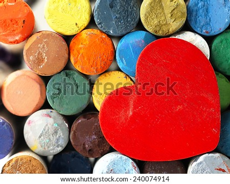 Heart on the background color, dry pastels. The visible surface of crayons.                                                - stock photo