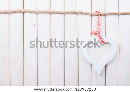 Heart on white wood background - stock photo