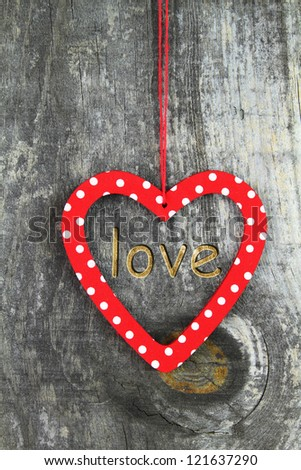 Heart ornament hanging on a tree