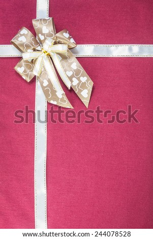 Heart pattern bow on red background - stock photo