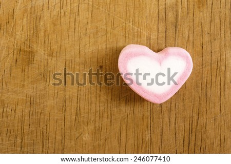 Heart pink marshmallow valentine's on old wood background. - stock photo