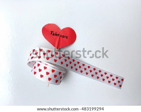 Heart print ribbon,heart icon ,take care wording on a white background.
