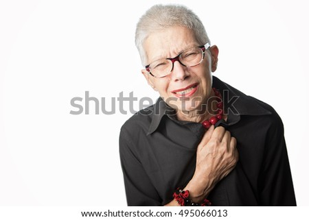 Heart problems, senior woman grabbing her chest expressing pain, having a heart attack
