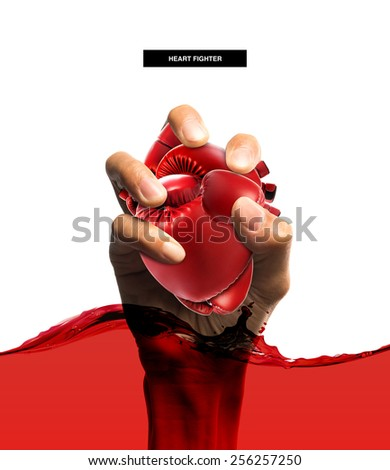 Heart protection medical concept,Heart shape made from boxing glove in hand and blood,isolated on white  - stock photo