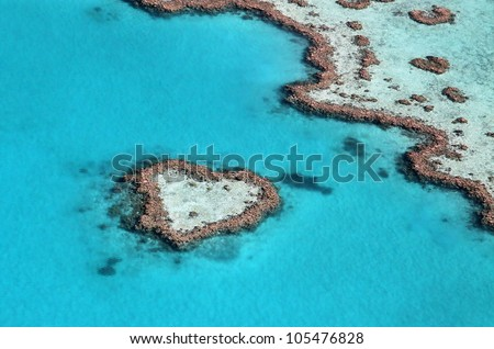 Heart reef impact in the tropical blue ocean - stock photo