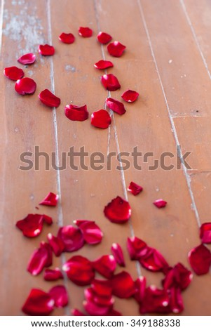 heart rose petals on the wood floor