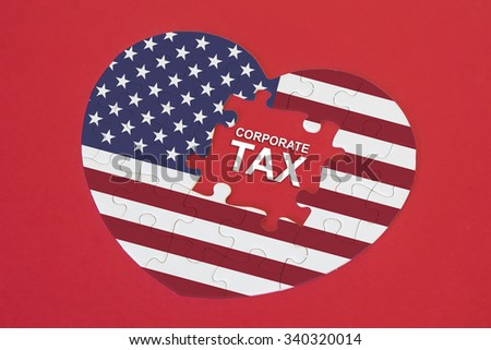 Heart shape America Flag jigsaw puzzle with a written word Corporate Tax with red background