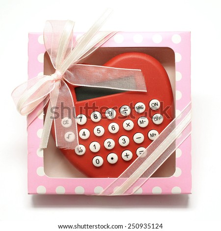 heart shape calculator in pink gift box isolated on white background - stock photo