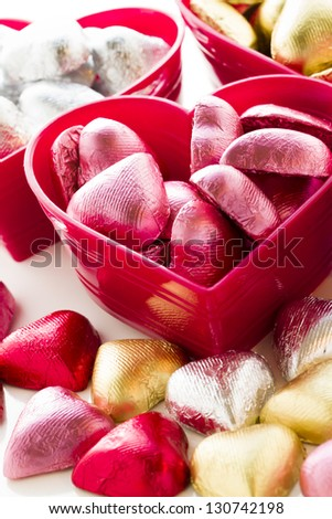 Heart shape chocolate candies wrapped in colorful foil for Valentine's Day. - stock photo