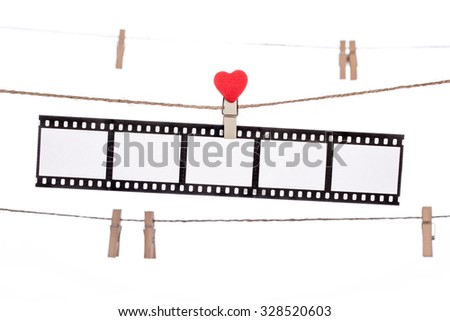 heart  shape clip on a clothesline , hanging Negatives, love movie memory