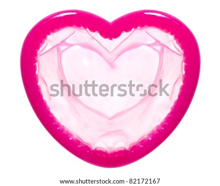 Heart shape condom - stock photo