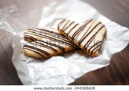 Heart shape cookies with milk chocolate stripes - stock photo