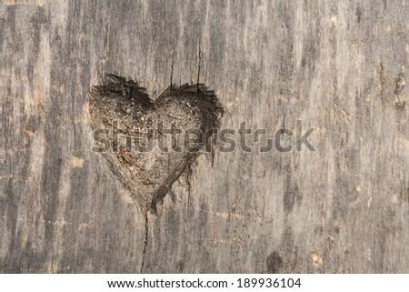 heart shape cut in wood - stock photo