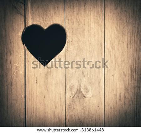 Heart shape cut on wooden wall, toilet, wc door or window - stock photo