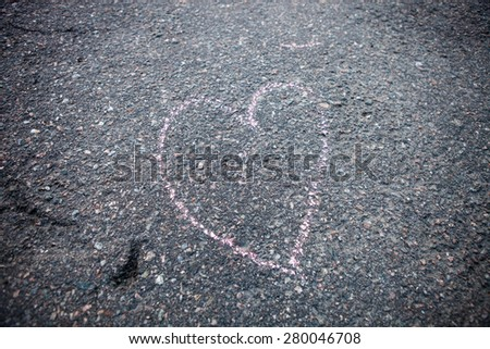 Heart shape drawind on the ground made with street chalk - stock photo