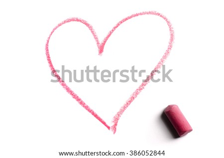Heart shape drawn in chalk isolated over white background. - stock photo