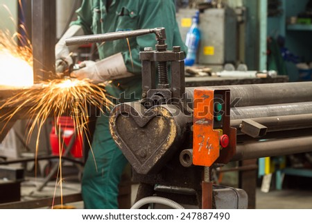 heart shape - end of hydraulic pressure steel bending roller - stock photo
