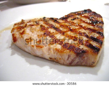 Heart shape fish steak - stock photo