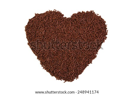 Heart shape formed with chocolate sprinkles isolated on white background. Love concept. Valentine's Day concept - stock photo