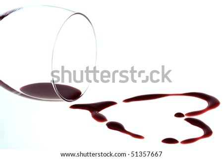 Heart shape from red wine isolated on white background