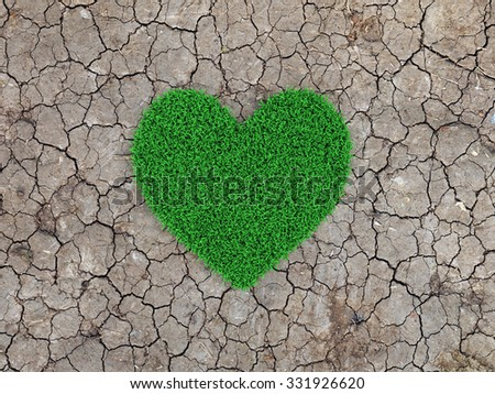 Heart shape Grass with cracked land - stock photo