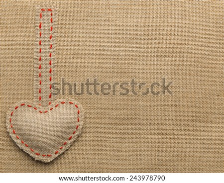 Heart Shape Hanging Object over Sackcloth Texture Background, Valentines Day Burlap  - stock photo