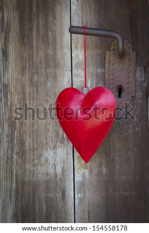 Heart shape hanging on door handle for valentine, christmas, wedding, mother's day, valentine or anniversary in country style for greeting cards.