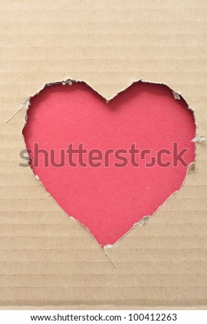 Heart shape hole through paper