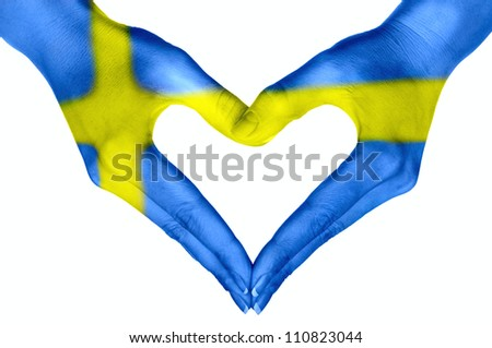 Heart  shape, human hands, painted Flag of Sweden - stock photo