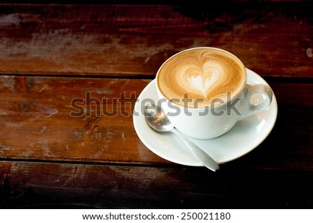 heart shape is on the top of coffee - stock photo